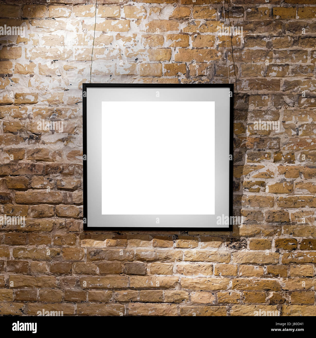 Empty frame on light brick wall. Blank space poster or art frame ...