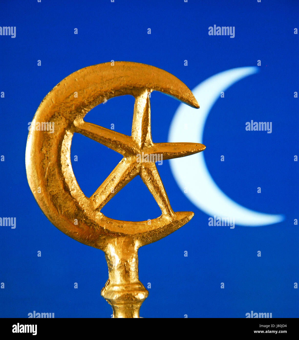 The crescent moon and star which became connected with Islam in the mid C20th. The  rich blue colour is often used - Stock Image