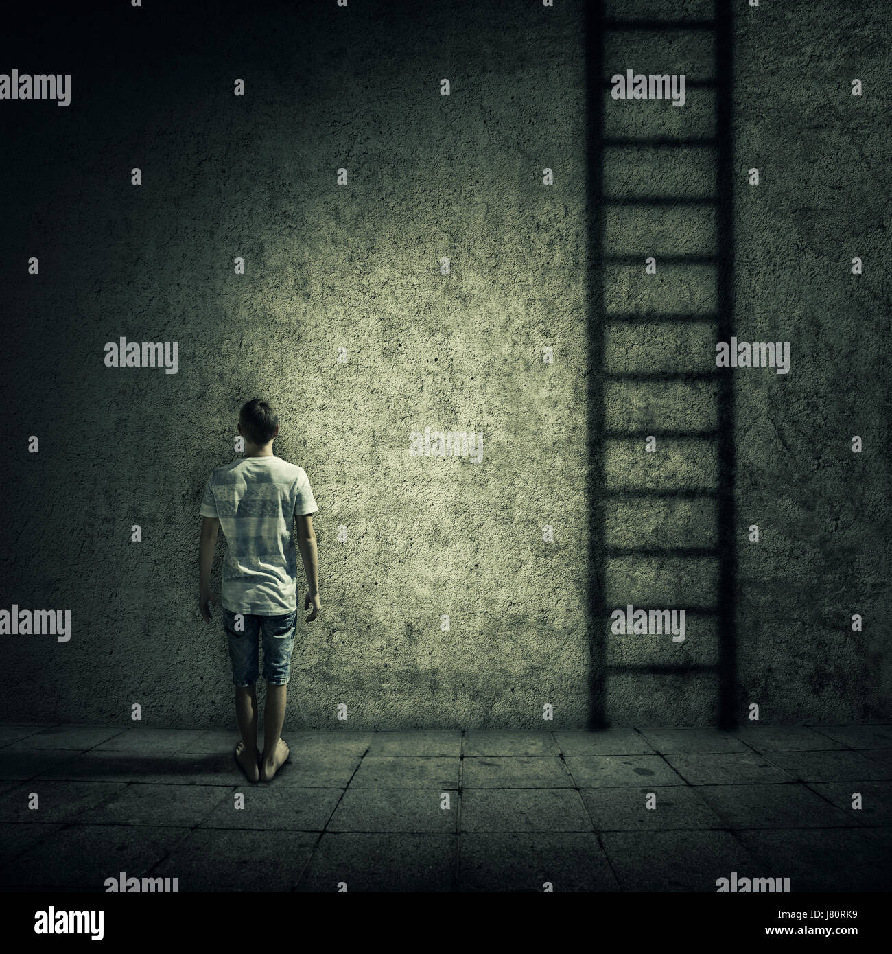 Abstract idea with a person standing in a dark room, in front of a concrete wall, figuring a ladder to escape. Surrounded - Stock Image
