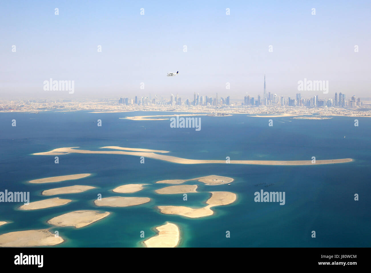 Dubai The World Islands Island Burj Khalifa aerial view photography UAE - Stock Image
