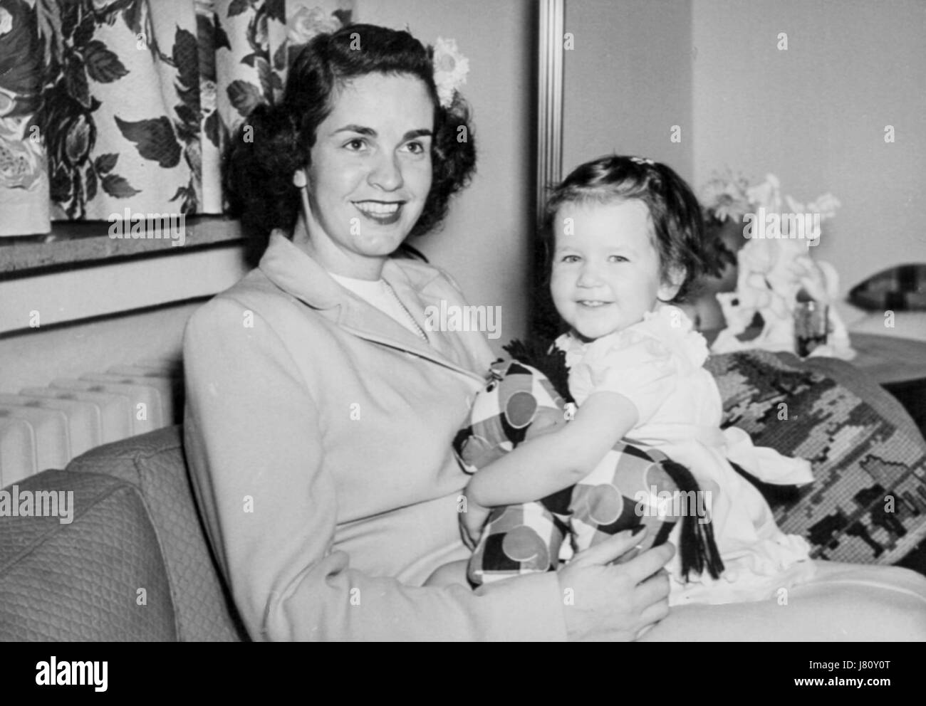 Mother and daughter 1950s vintage black and white photograph stock image