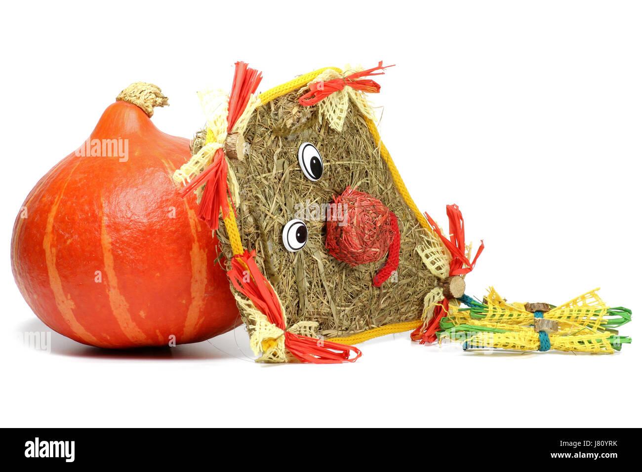red kuri squash and kite made of straw isolated on white background Stock Photo