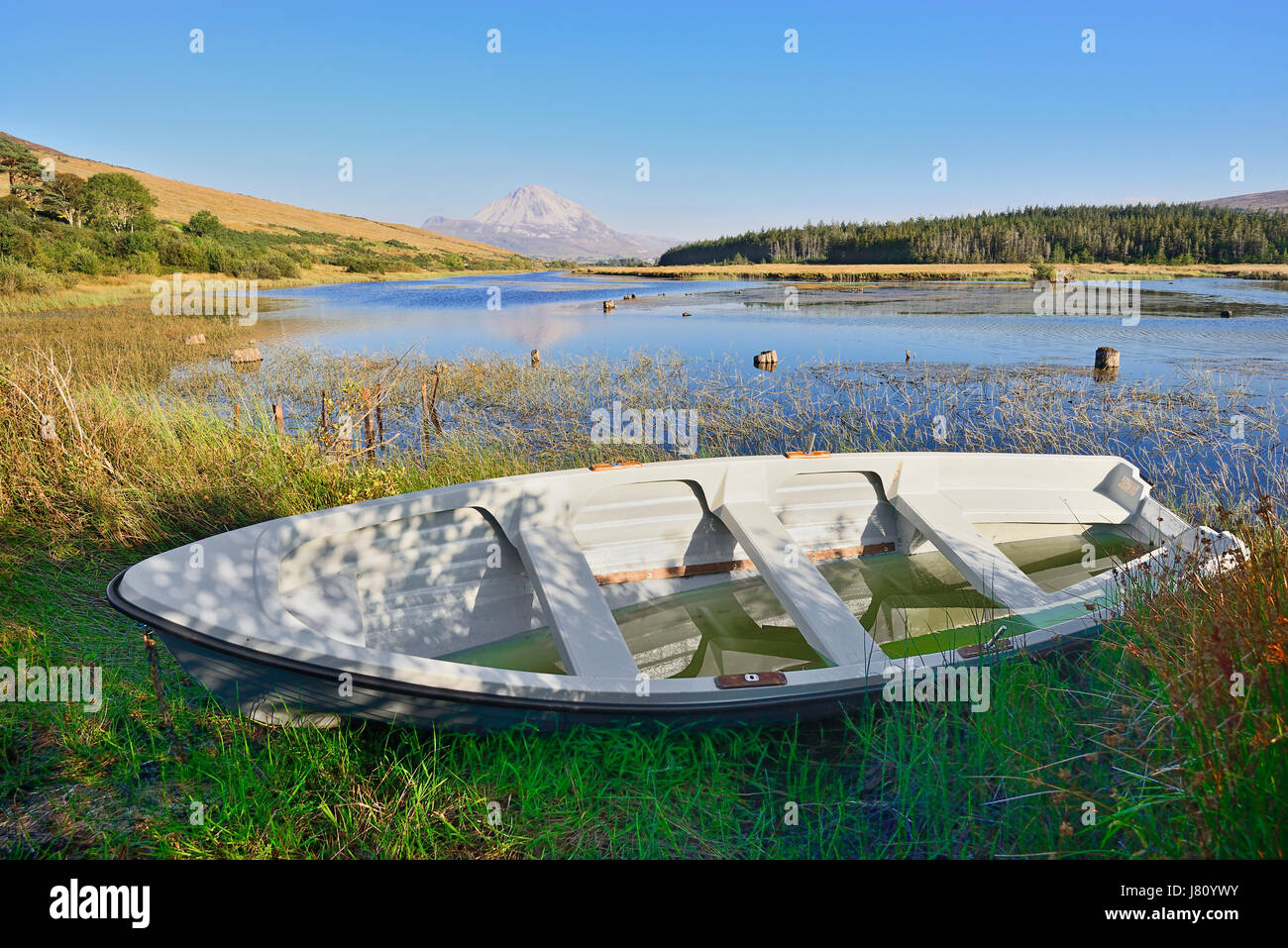 Ireland,County Donegal, Clady River with Mount Errigal in the distance and a rowing boat in the foreground. - Stock Image