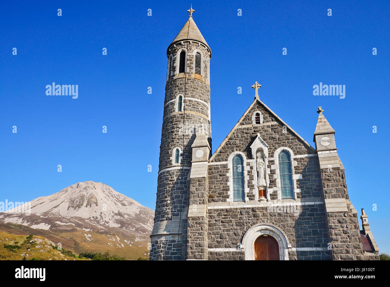 Ireland,County Donegal, Dunlewey,Church of the Sacred Heart with Mount Errigal in the background. - Stock Image