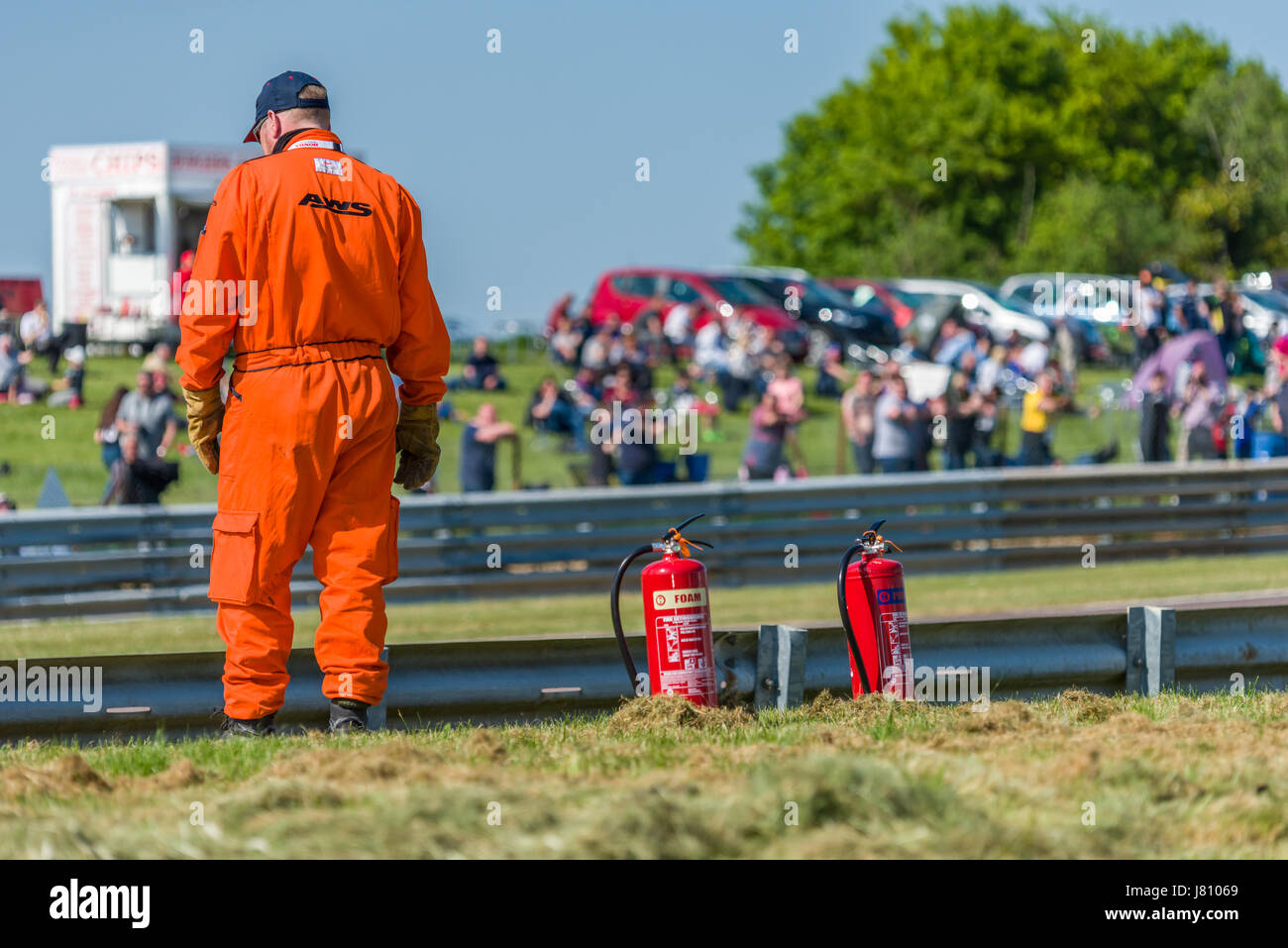 A Motorsport Marshal stationed at his post during the 2017 BTCC meeting at Thruxton. - Stock Image