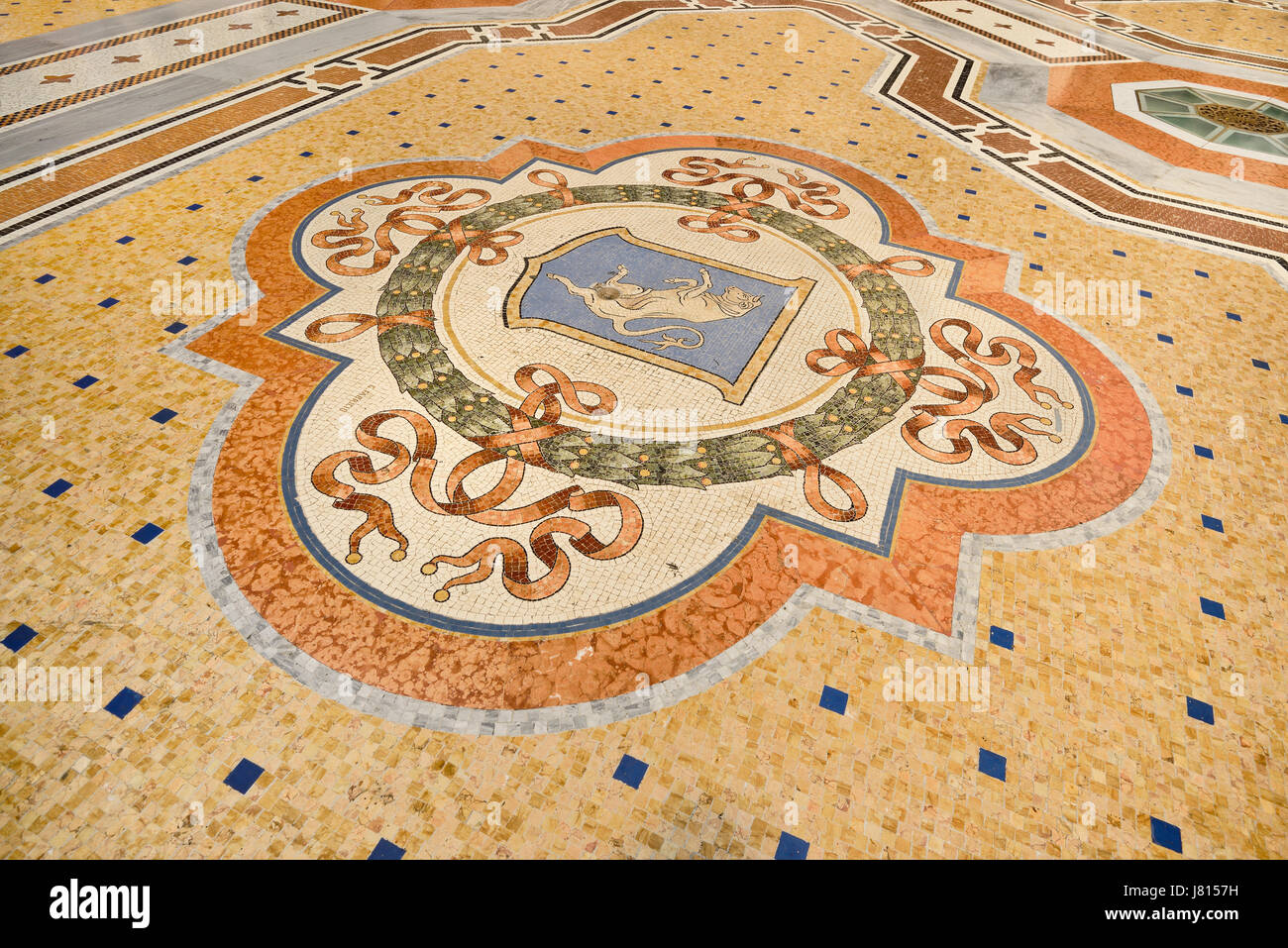 Italy, Lombardy, Milan. Galleria Vittorio Emanuele, Famous bull mosaic on the floor where tradition says that if - Stock Image