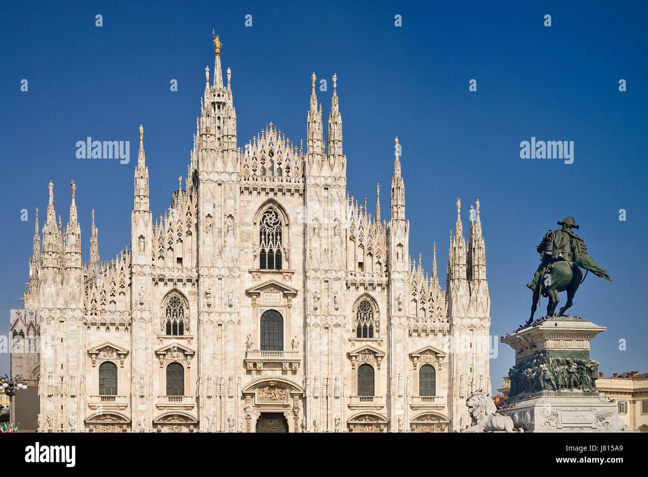 Italy, Lombardy, Milan. Milan Duomo or Cathedral, A section of the facade with the statue of King Victor Emmanuel - Stock Image