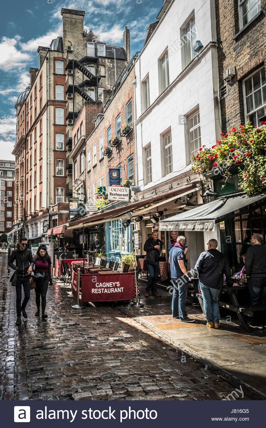 A rain soaked Cosmo Place, Bloomsbury, London, WC1, UK - Stock Image