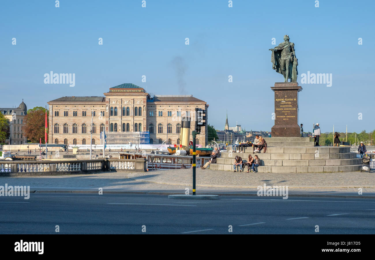 View from Slottsbacken in Stockholm towards the statue of king Gustaf III and the National Museum of Fine Arts - Stock Image