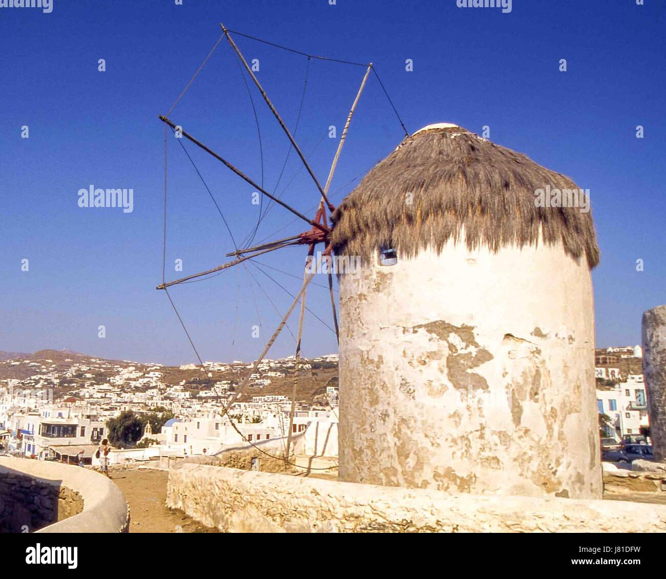 Chora, Mykonos, Greece. 3rd Oct, 2004. The famous iconic windmills (Kato Mili) in Chora, Mykonos, on a hill overlooking Stock Photo