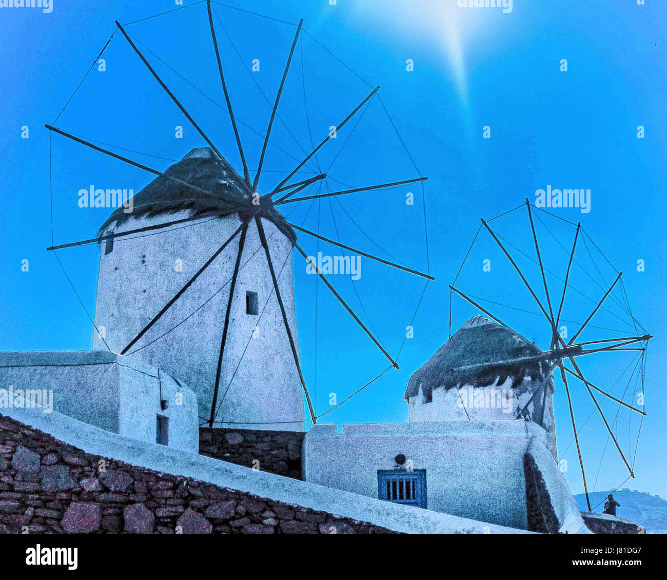 Chora, Mykonos, Greece. 9th Oct, 2004. The famous iconic windmills (Kato Mili) in Chora, Mykonos, on a hill overlooking Stock Photo