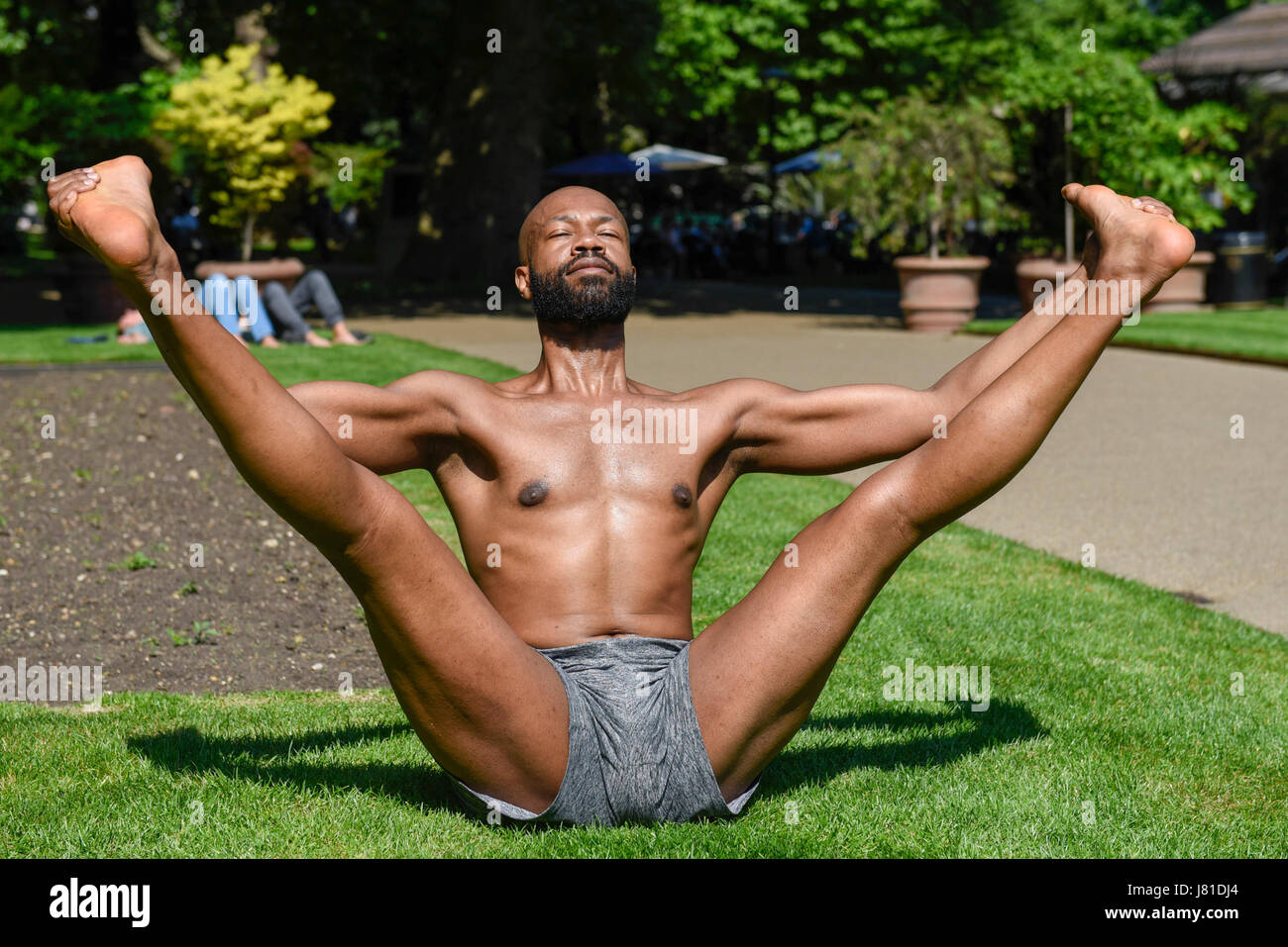 London, UK. 26th May, 2017. Gerrard Martin, a dancer and yoga teacher, practices yoga in the hot weather and bright - Stock Image