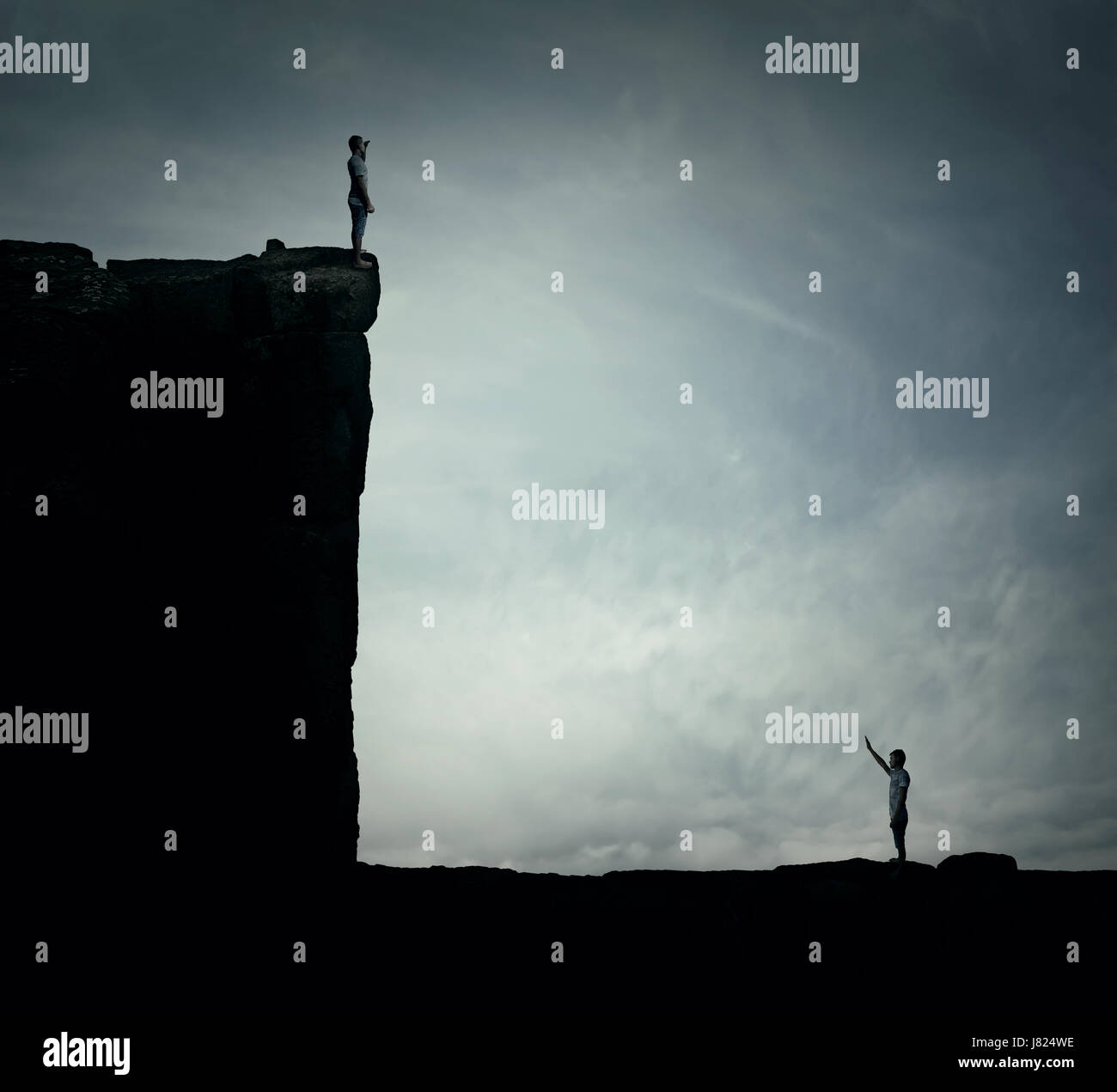 Conceptual image with two lost persons standing on a cliff at different hights, trying to find each other. Parallel Stock Photo