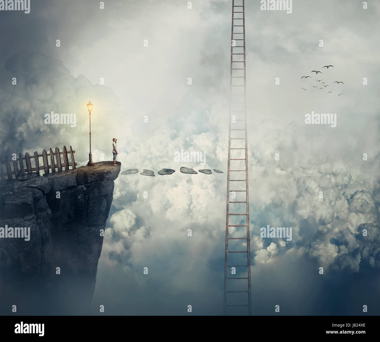 Imaginary view as a young boy stand on the peak of a cliff above clouds thinking how to reach a ladder going up Stock Photo