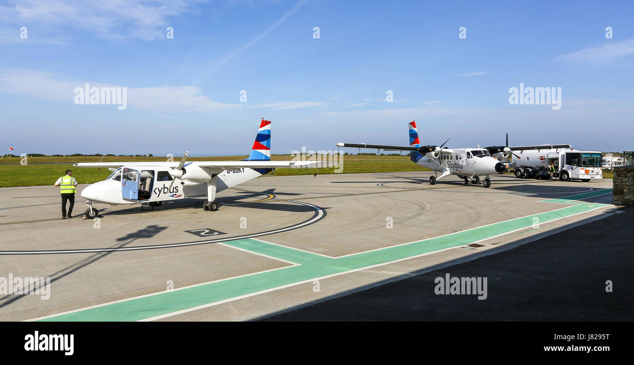 A Britten-Norman BN-2 Islander and a De Havilland DHC-6-300 Twin Otter Isles of Scilly Skybus aeroplanes or aircraft - Stock Image