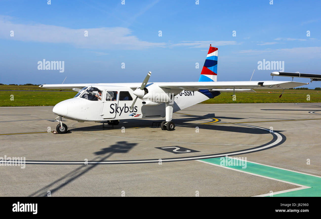 A Britten-Norman BN-2 Islander Isles of Scilly Skybus aeroplane or aircraft shuttle service between Lands End airport - Stock Image