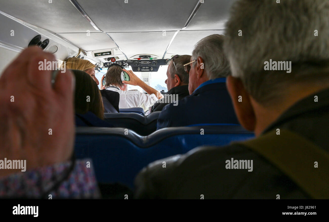 Passengers on a Britten-Norman BN-2 Islander Isles of Scilly Skybus aeroplane or aircraft shuttle service between - Stock Image