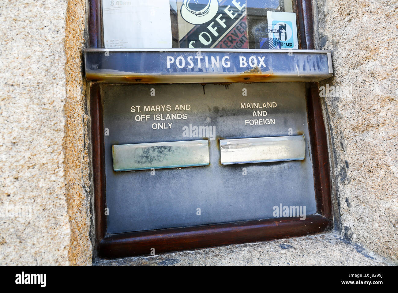 A posting or post box or letter box at Hugh Town, St. Mary's, Isles of Scilly, Cornwall, England, UK - Stock Image