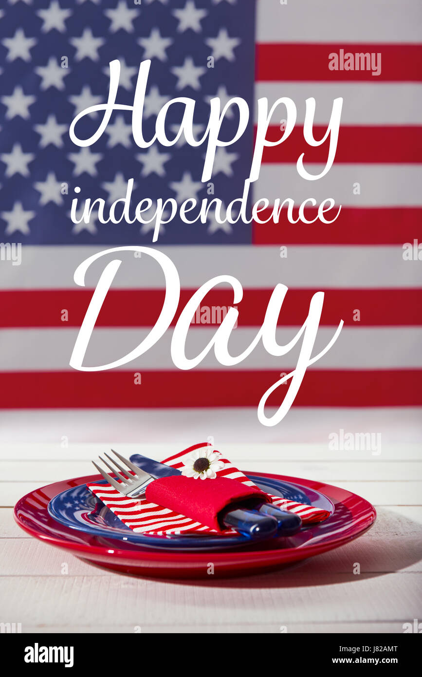 Beautiful blue red and white table setting in front of american flag, Happy independence day dinner concept - Stock Image