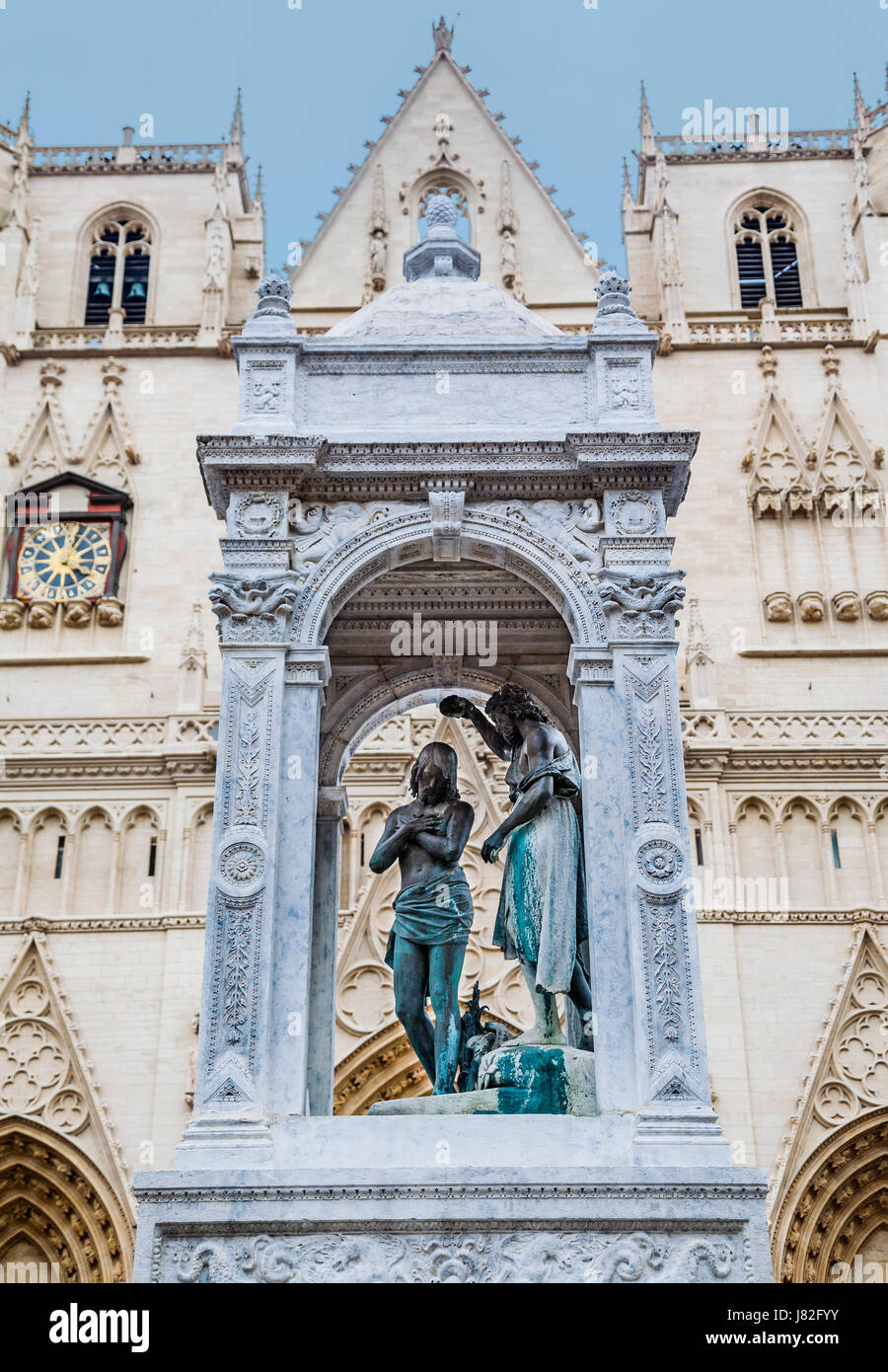 France, Lyon, The Baptism of Christ, an arcaded set of statues on a fountain at the front elevation of St. John - Stock Image