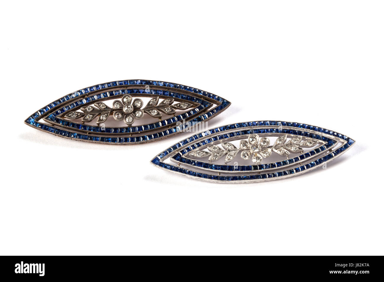 Two sapphire and diamond navette shaped brooches. Estimated value £2,500 each Stock Photo