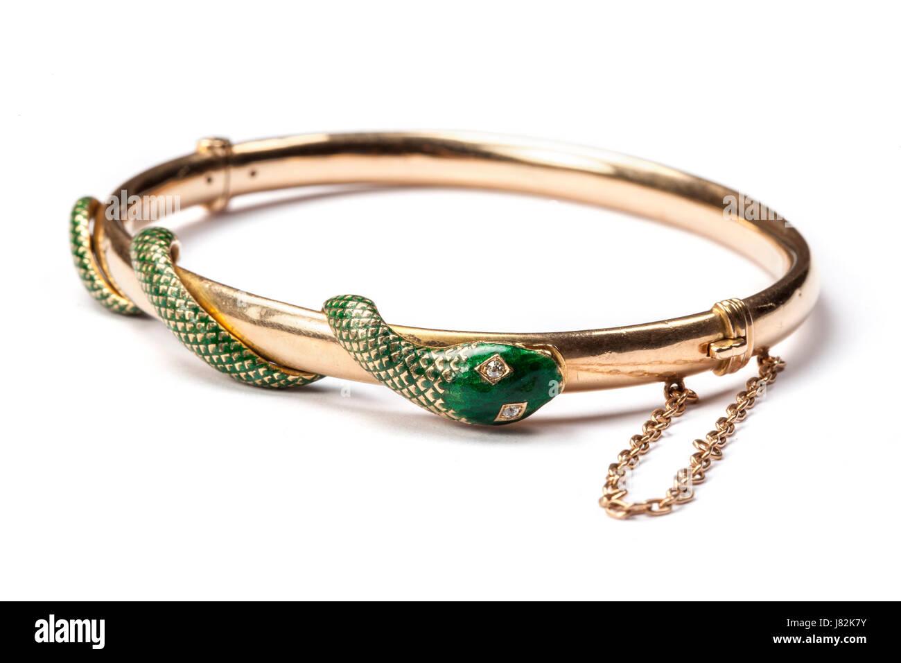 An enamelled snake entwined hinged gold bangle - Stock Image