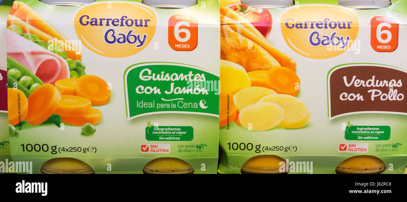 Carrefour supermarket own brand baby food ( left: Peas and Ham, right: chicken and vegetables ) - Stock Image