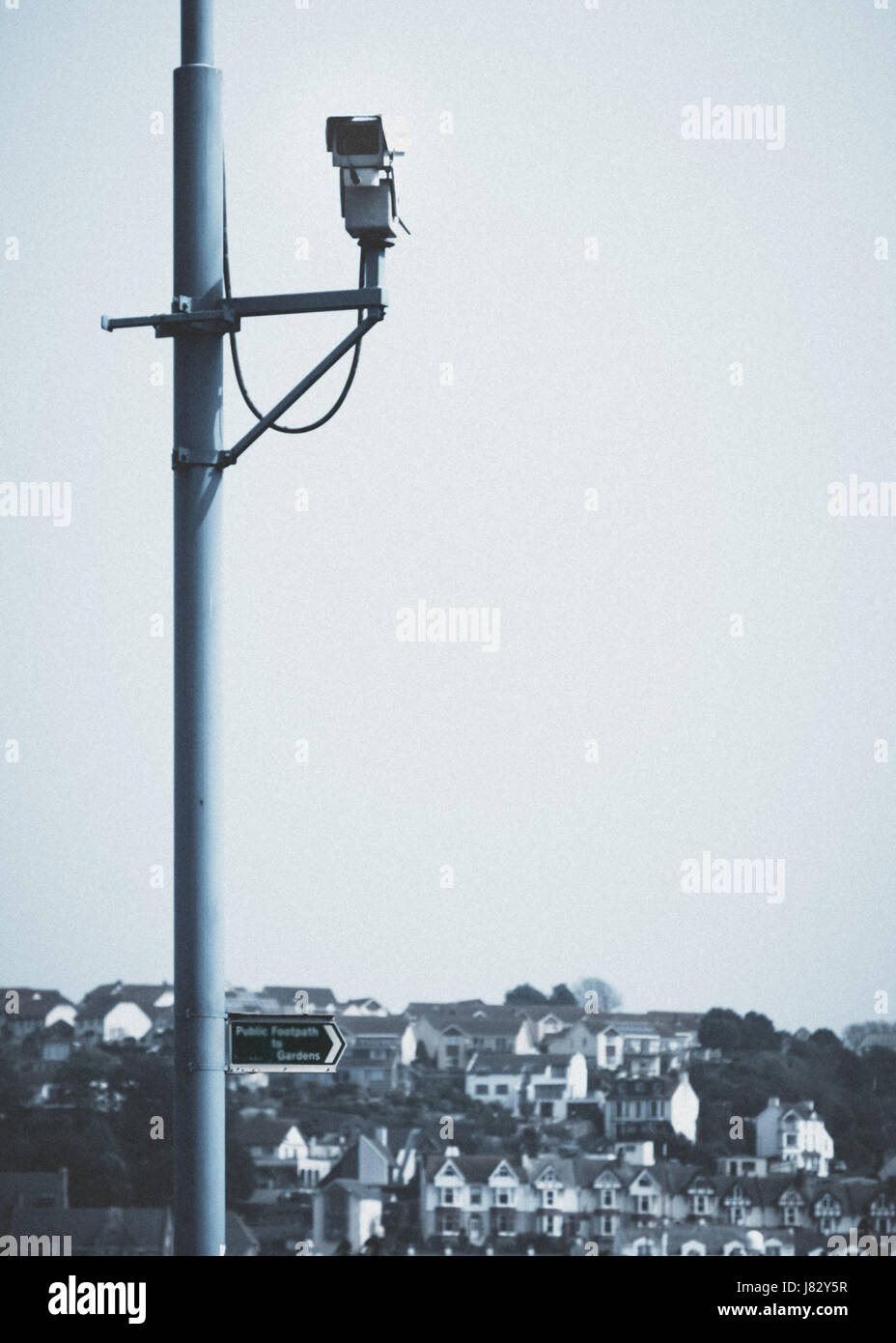 Video surveillance camera overlooking the houses and harbour in Brixham, Devon. Stock Photo