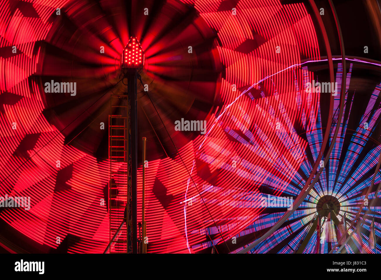 Ferris wheel in motion with multicolors and abstract patterns of colors Stock Photo