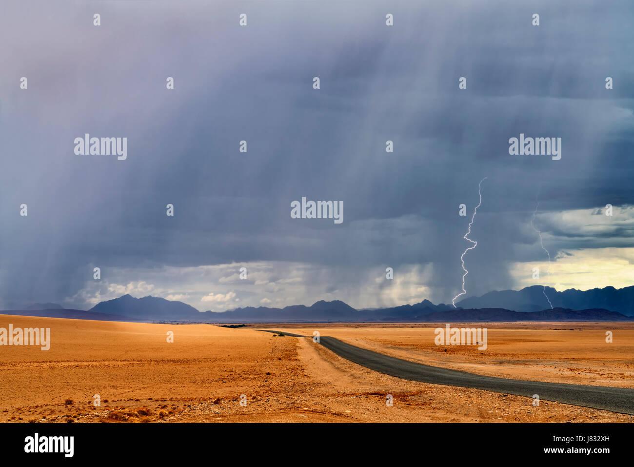 Desert road with lightning storm - Stock Image