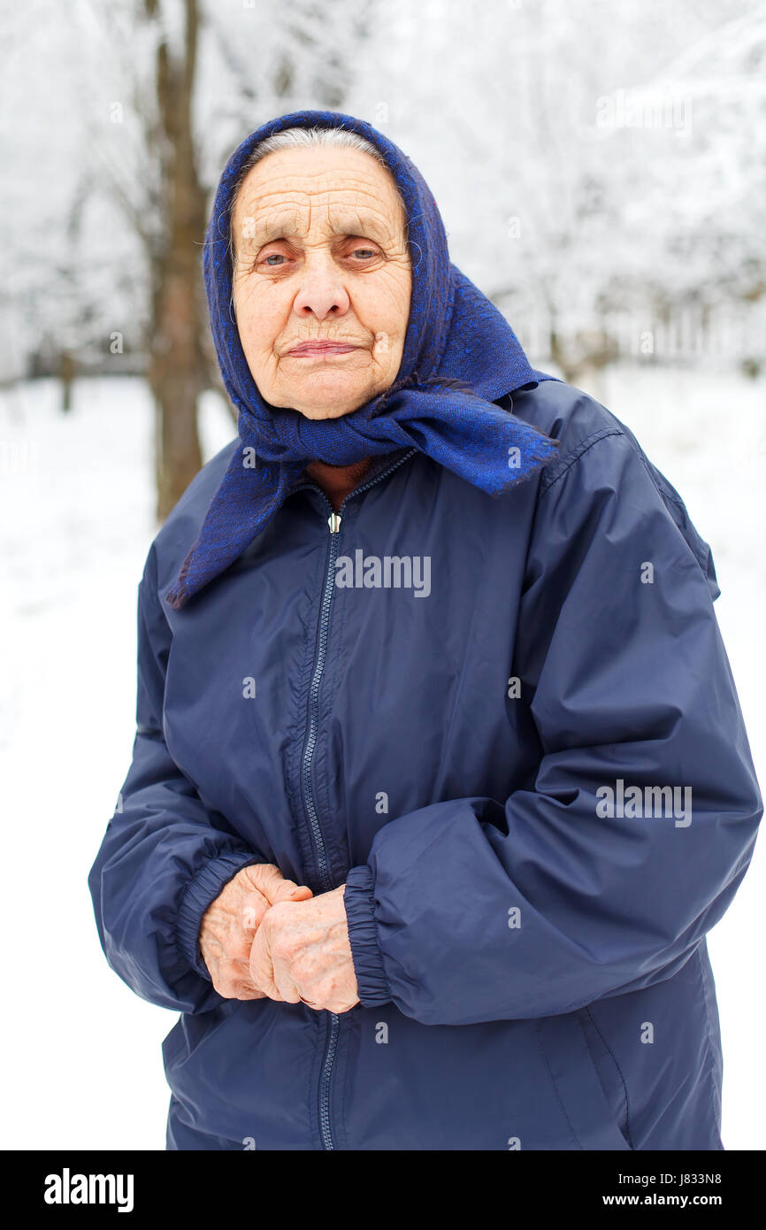 Portrait of an old retired woman on wintertime - Stock Image