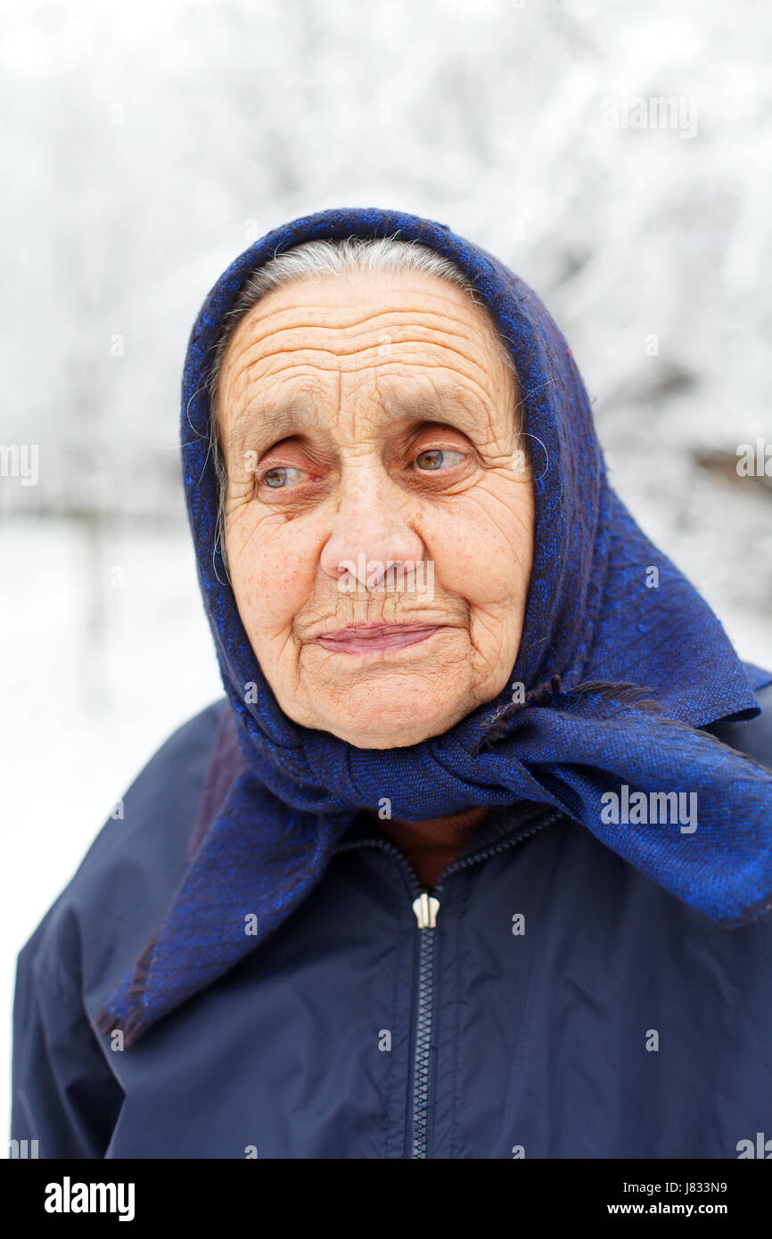 Portrait of a smiling retired woman on wintertime - Stock Image