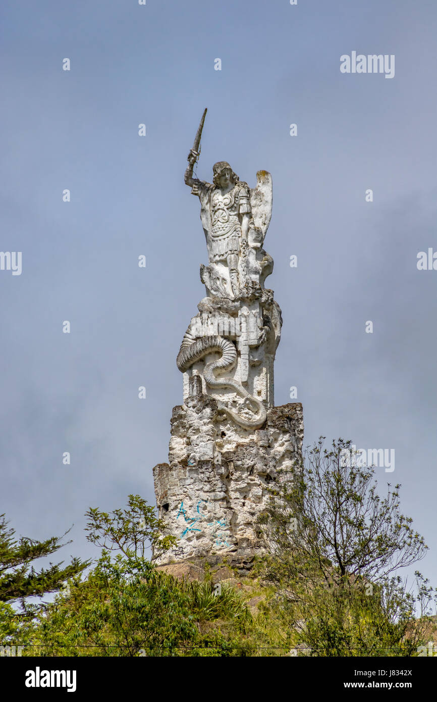 Archangel Michael and the Beast Statue near Las Lajas Sanctuary - Ipiales, Colombia - Stock Image