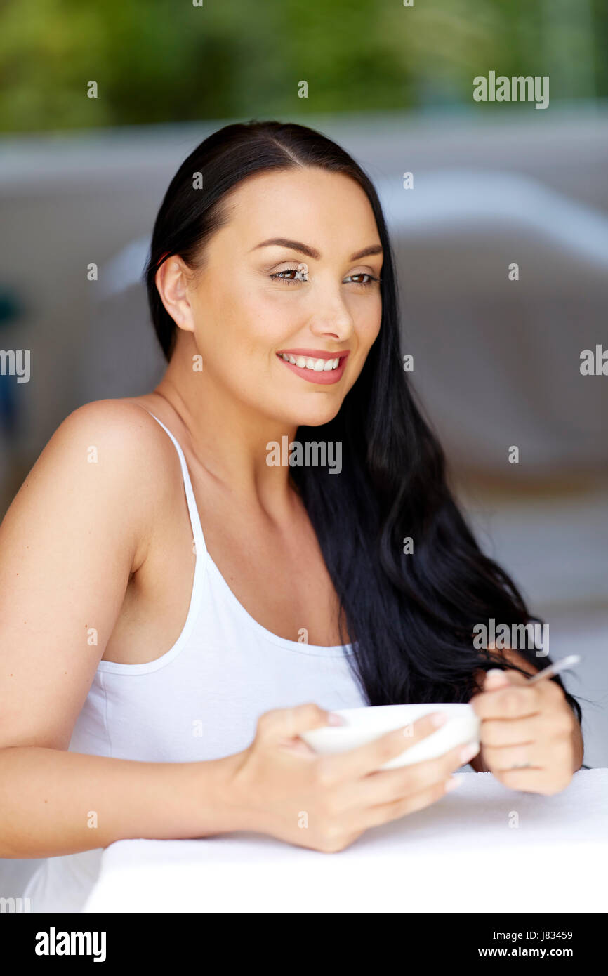 Beautiful woman eating - Stock Image