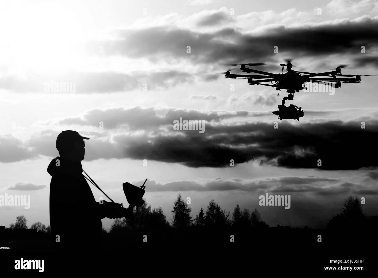 Drone, Unmanned copter flight, pilot flying drone - Stock Image
