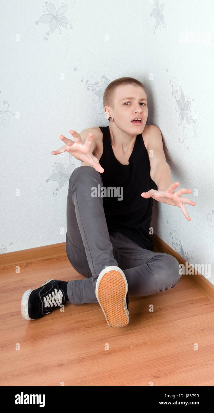 hand pain fear frightened anxious afraid teenager depressed hand model  design - Stock Image