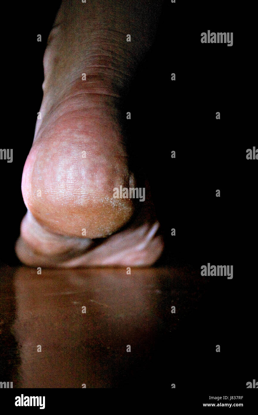 A different perspective of my bare foot. - Stock Image