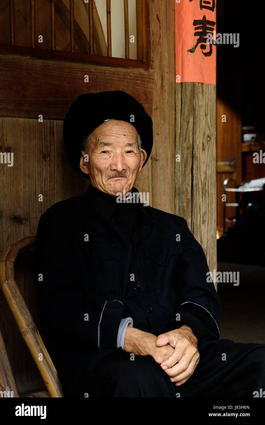 Elderly Chinese man living in Linkeng or Lingshang Renjia ancient village, Yongia County, the Nanxi River area known - Stock Image