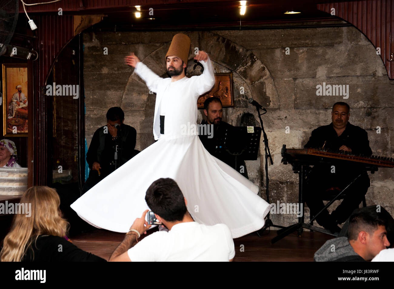 Istanbul, Turkey - May 7, 2017: The dance Whirling Dervishes is called Sema while peoples watch him - Stock Image