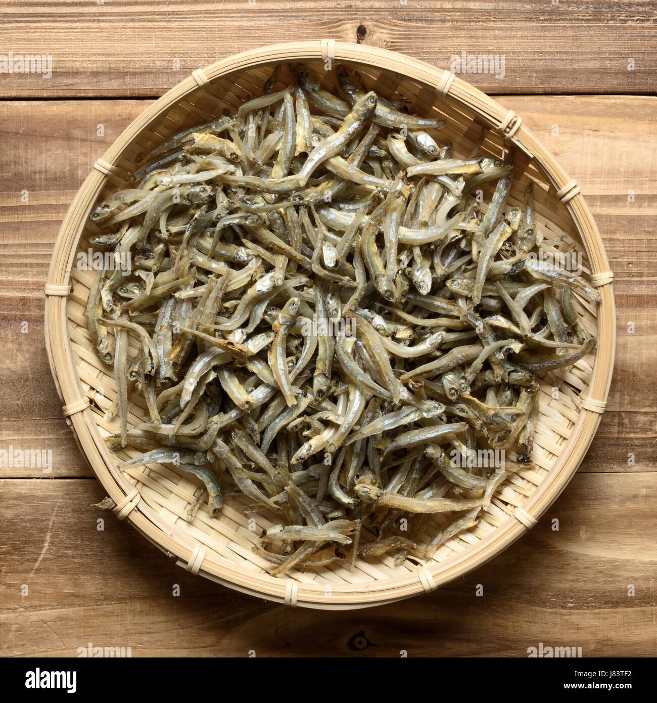 angle fish dried uncooked preserved anchovy anchovies food aliment colour - Stock Image