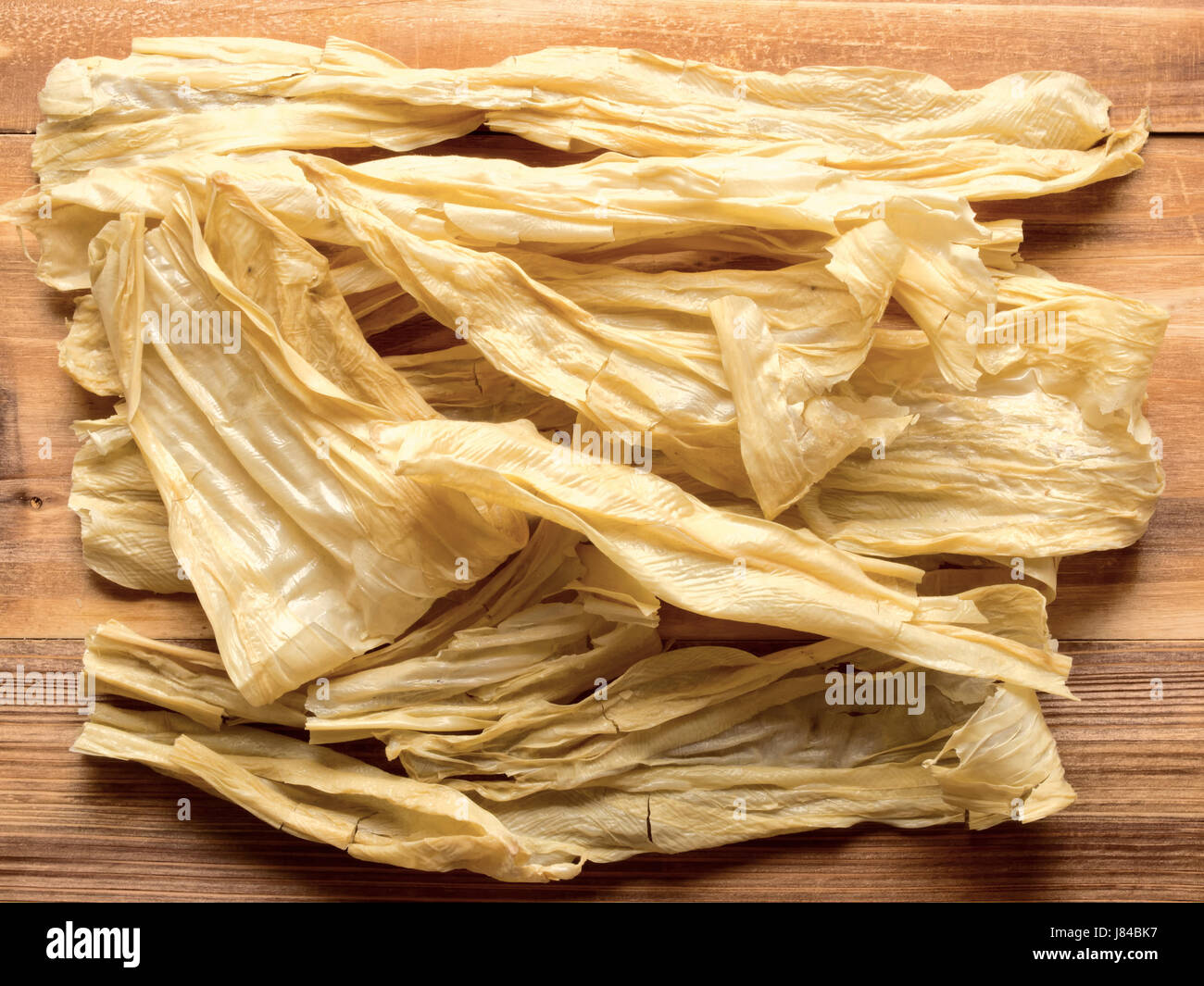 skin dried curd curds preserved bean stick food aliment colour skin horizontal - Stock Image