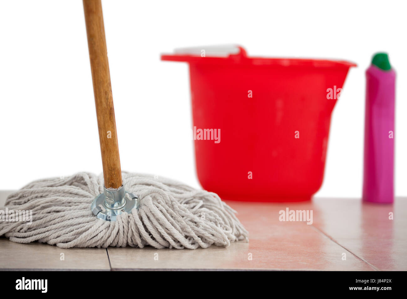 Close-up of mop cleaning the tile floor - Stock Image
