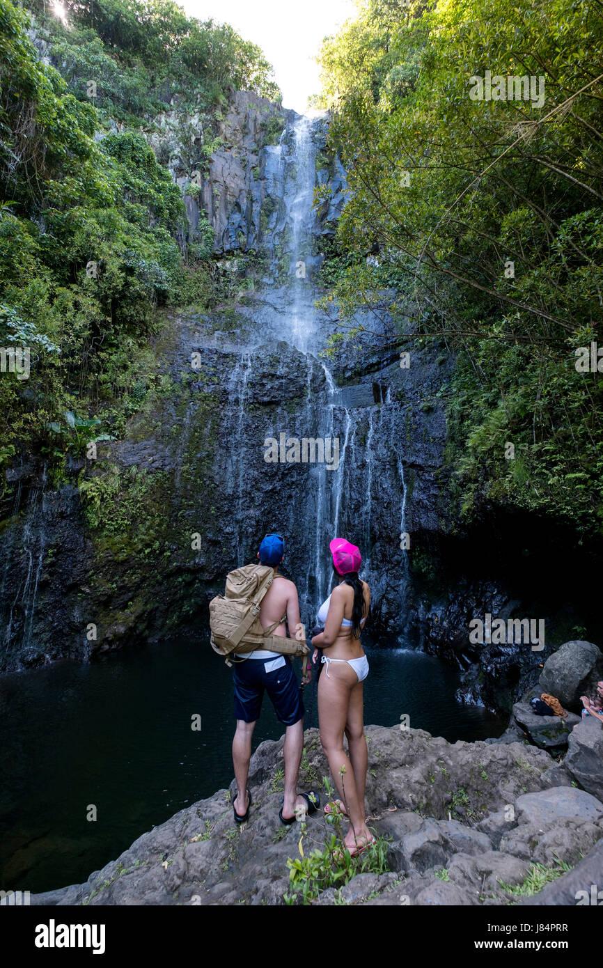 visitors at Wailua Falls, near Hana, Maui, Hawaii Stock Photo