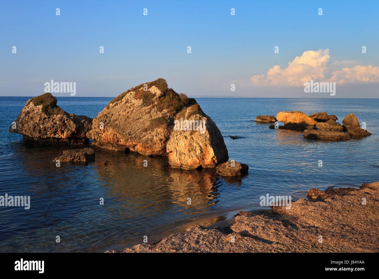 blue beautiful beauteously nice isolated relaxation stone greece beach seaside - Stock Image