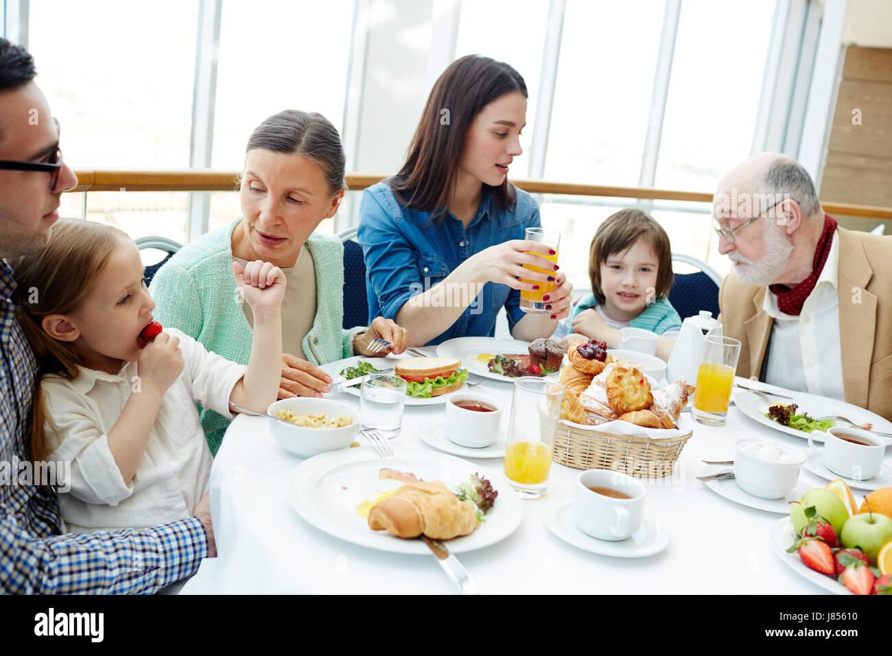 Big family of three generations having breakfast in restaurant - Stock Image