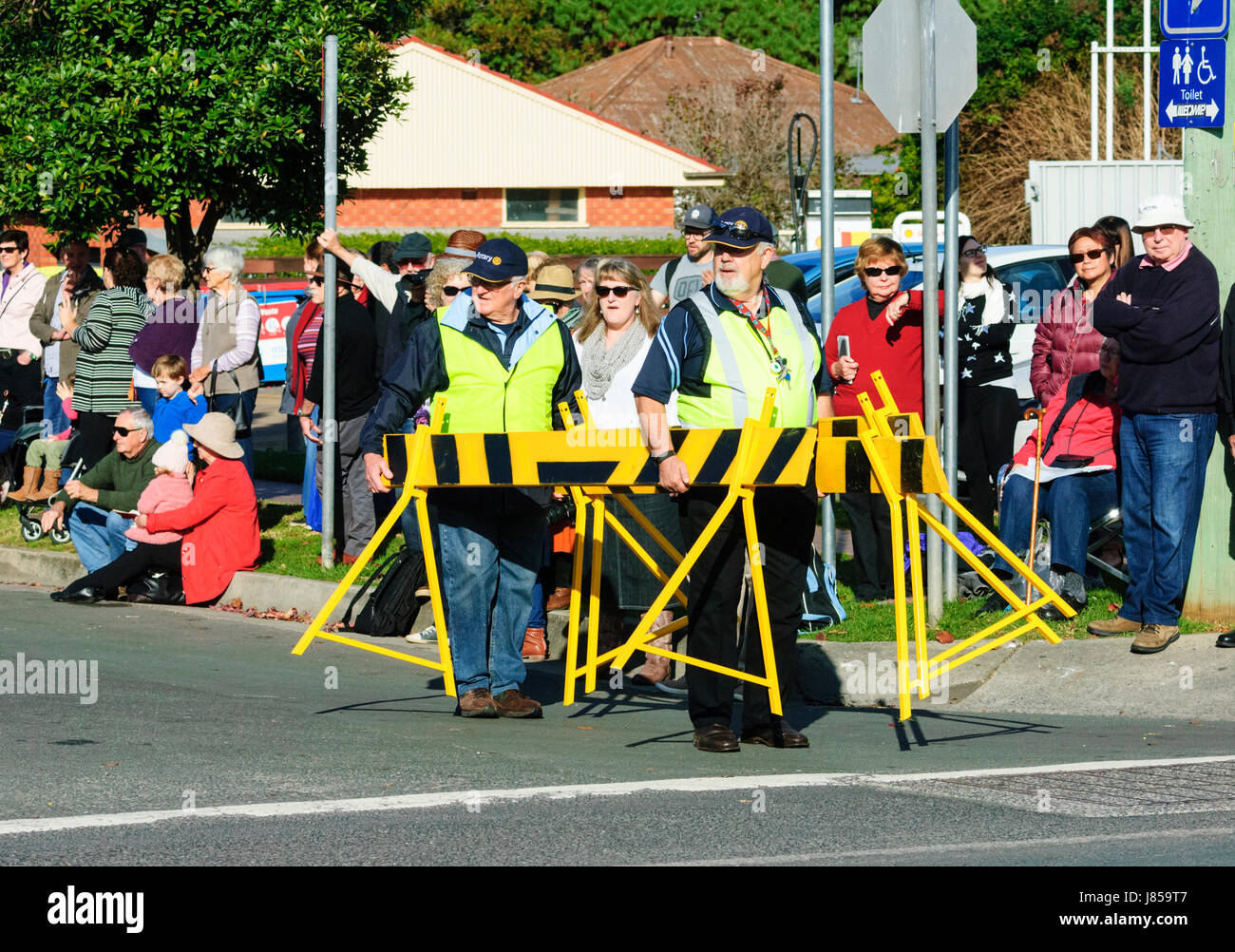 Crowd control operatives wearing hi vis jackets closing off the street during a festival, Berry, New South Wales, - Stock Image