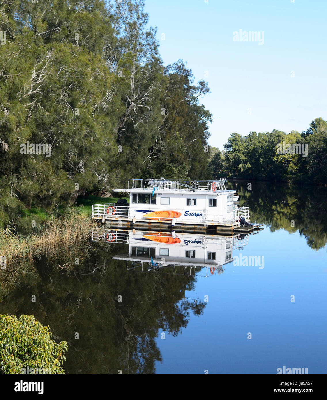 Holiday Boat at Broughton Creek, near Berry, New South Wales, NSW, Australia - Stock Image
