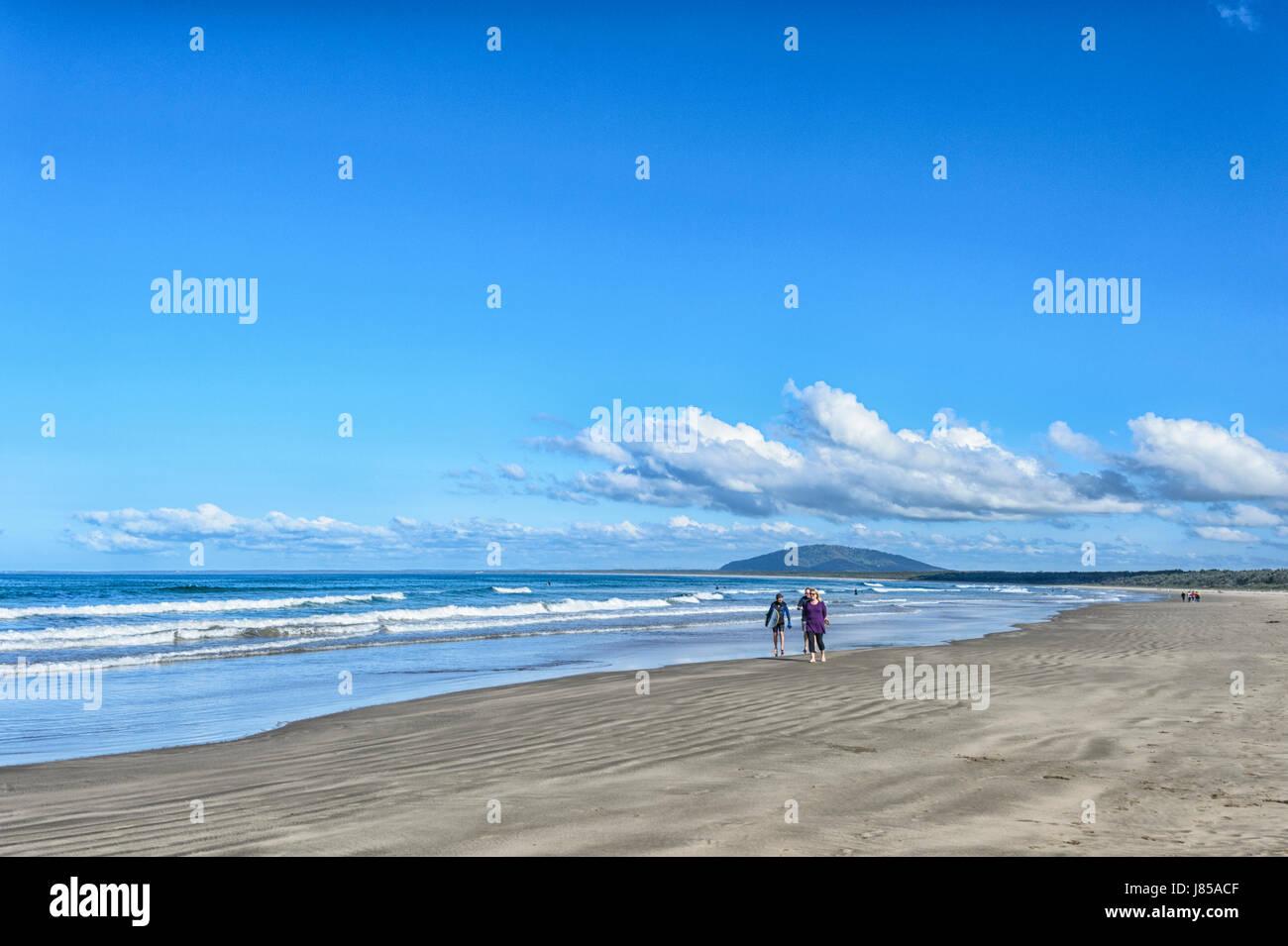 People walking on scenic 7 Mile Beach, Gerroa, New South Wales, NSW, Australia - Stock Image