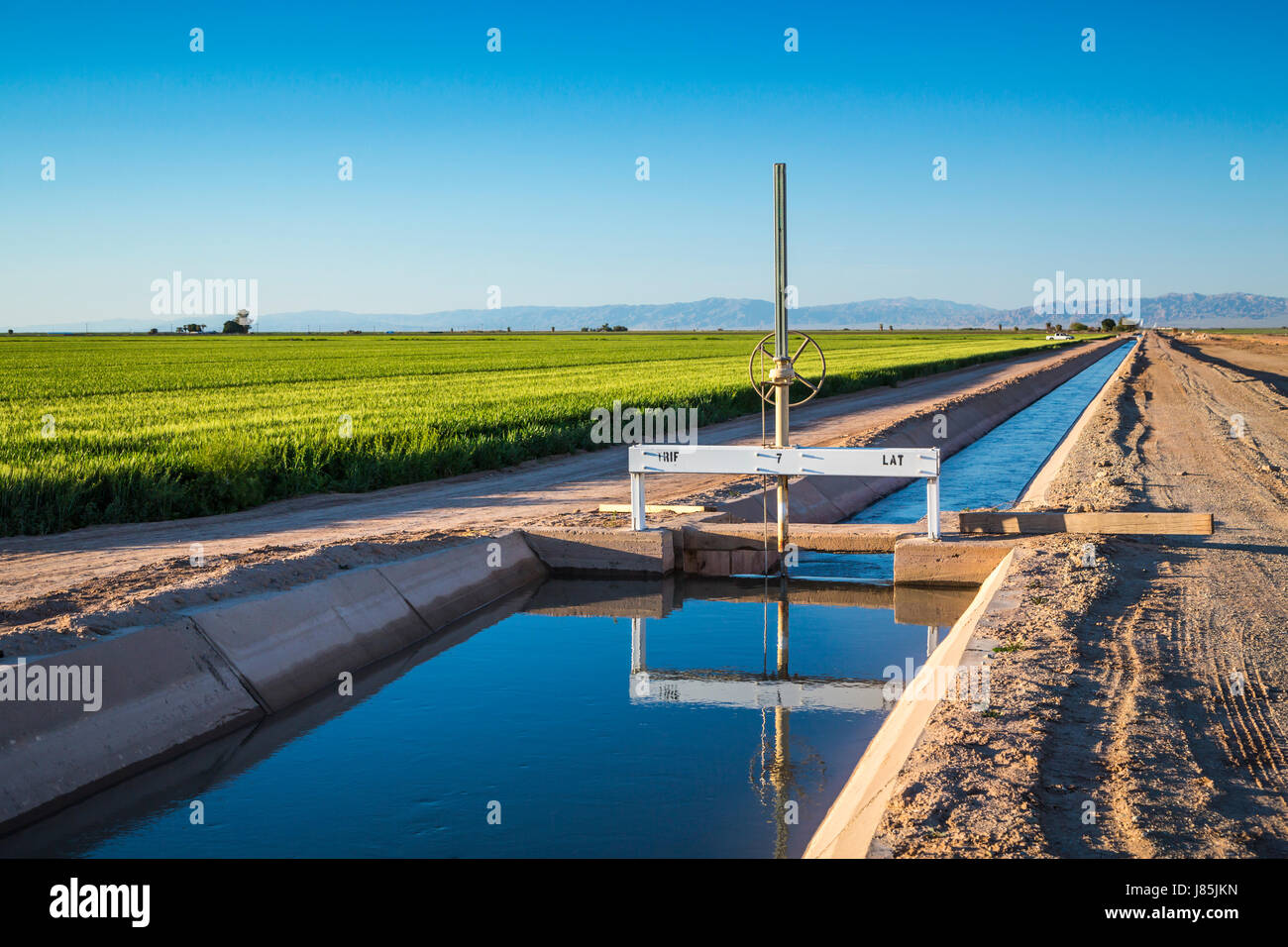 Agricultural irrigation canals and control facilities in the Imperial Valley of California, USA. - Stock Image