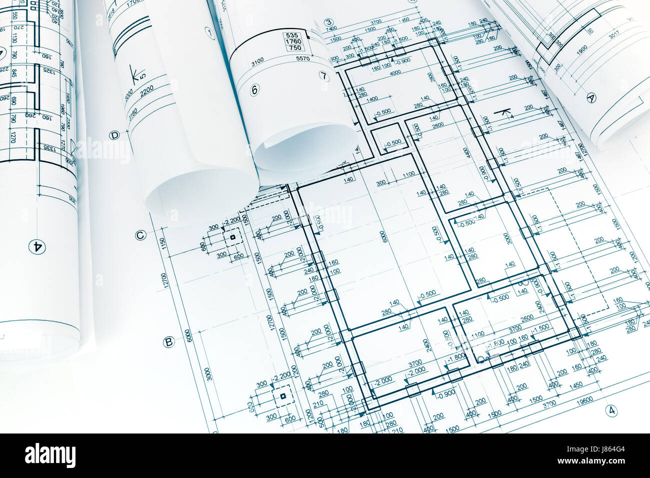 Rolled building plans on architectural project blueprint background rolled building plans on architectural project blueprint background malvernweather Image collections
